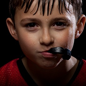 Young boy with athletic mouthguards